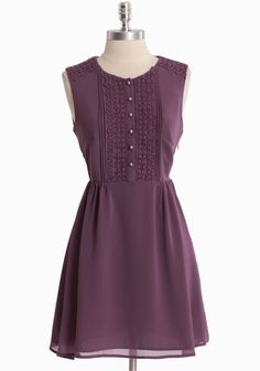"""Kathy Orchid Dress By Darling UK 94.99 at shopruche.com. Fall in love with this romantic plum dress crafted in delicate georgette by Darling UK. Perfected with charming crochet accents, glowing pearlescent button closures, and a fitted waist for a defined and flattering silhouette. Hidden side zipper closure. Fully lined.Shell: 100% Polyester, Lining: 100% Polyester, Lace: 100% Cotton, 33"""" length from top..."""