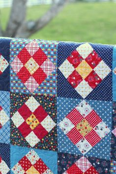 Finally sharing my fourth pattern from the new Gingham Girls collection – this one is called A Stitch in Time. It's based on very traditional quilting (nine-patch) designs and I really like way the fabrics and the design work together for this the old-fashioned feel.   This pattern is precuts (2 1/2″ strips) friendly and comes together quickly with strip-piecing techniques. I pieced a back for this one featuring the red gingham daisies and the yellow calico print. I really wanted to roun...