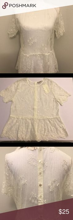 Lace Peplum Blouse in Cream This delicate top is a great addition to dress up a pair of jeans. Is see thru lace. Tops Blouses