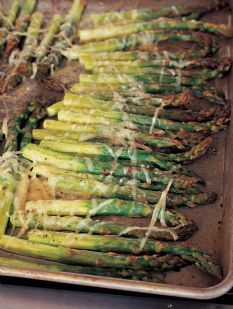 2 1/2 pounds fresh asparagus (about 30 large)   2 tablespoons olive oil   1/2 teaspoon kosher salt   1/4 teaspoon freshly ground black pepper   1/2 cup freshly grated Parmesan cheese   2 lemons cut in wedges, for serving   Drizzle asparagus with oil & salt & pepper - roast for 15 minutes sprinkle with parmesan and return to oven
