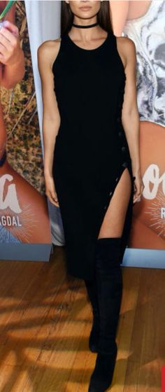 Love this drape dress on Her. She looks absolutely stunning with thigh high boots