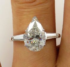This a Beautiful Estate Vintage Pear Shaped Solitaire Ring with 2 Large baguettes ,Shy of the full 3 ct in total weight ( 2.90ct ).   Buy her