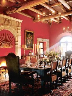 Designer Rachel Horn highlighted the strong architectural elements of this dining room in San Miguel de Allende, Mexico by painting the walls a rich red. (Photo: Photo: Jeremy Samuelson; Designer: Rachel Horn)