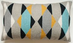 Hand embroidered geometric pillow by Leah SIngh
