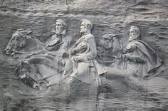 The carving on Stone Mountain, is an Confederate memorial in Georgia featuring Jefferson Davis, Robert E. Lee and Thomas 'Stonewall' Jackson. Stone Mountain Georgia, Mountain Park, Stonewall Jackson, Confederate States Of America, Confederate Leaders, Ga In, Famous Landmarks, Down South, American Civil War