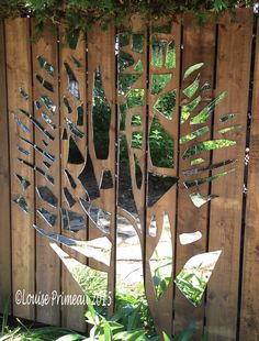 Louise's ARTiculations..recycling an old closet mirror and reusing it on our backyard fence. Instructions on my website.