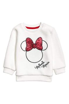 White/Minnie Mouse. Sweatshirt in soft fleece with a motif at front, snap fasteners on one shoulder, and ribbing at neckline, cuffs, and hem.