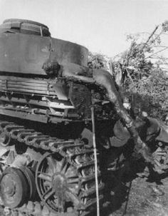 More of the carnage.... The charred remains of a German tanker on the back of his knocked out Panzer IV.