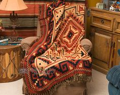Native American style southwest woven jacquard throw blanket with fringed edges.This is double woven and very soft, perfect for a furniture throw, picnic blanket, wrap or for home decorating. This w