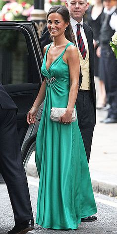 Pippa heading to the private wedding reception wearing a custom made emerald-green stunner with sparkling detailing by Temperley London