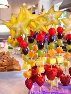 """Gorgeous fruit """"wands"""" with starfruit toppers!"""