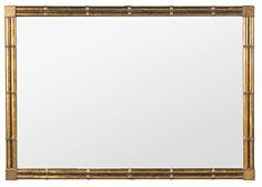 Espejo de estilo oriental en madera tallada y dorada de Pierre Lottier, de mediados del siglo XX