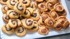 puff pastry pinwheels Ingredients / mortadella and provolone cheese pinwheels Makes + 20 pinwheels Prep 5 min - Baking 10 to 15 min      12 cm * 30 cm sheet of puff pastry, approx.     50g of provolone cheese, grated. Or use your favourite cheese     100g of grated mortadella or any sort of cold cut you like, preferably spicy     1 egg yolk for egg wash (If you have made the previous recipe as well, use its egg wash)     Salt, freshely ground black pepper and cayenne to taste