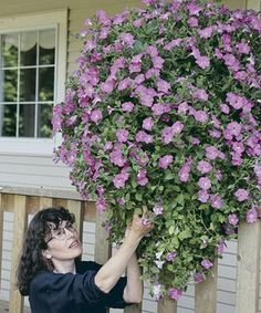 Make your own hanging baskets!  Step by step instructions to make baskets so that they'll last.  Tip; Walmart has the wire baskets and liners at great prices!