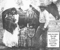 Poker Bill and family in Yosemite. Left to Right; Yosemite icon Suzie Bill (McGowan), without her headscarf holding Sadie McGowan still in her signature plaided blanket, daughter Carrie Bill (McGowan) who later became the famous Indian basket maker Carrie Bethel, daughter Minnie Bill (McGowan) who later became the famous Indian basket maker Minnie Turner - Minnie Mike, then Suzie's husband and father of the children, Poker Bill, son of Captain Jim.