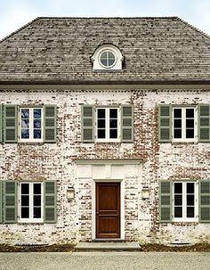 Pristine door w/worn painted brick - Fairfield Residence, New England