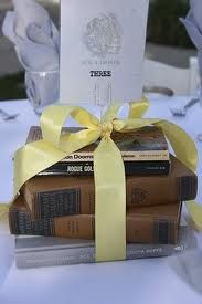 Stacked books with a decorative ribbon