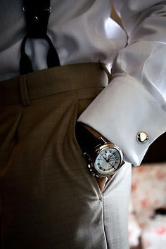 French cuffs (I worked for a President of a Bank that always wore french cuffs and cuff links.  He was not only incredibly well groomed, but one of the most genuinely nice people I have ever had the pleasure to know; and that made him twice as chic!)