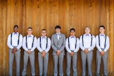 Groomsmen in Gray Pants and White Shirts With Blue Suspenders
