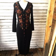 Brocade on Heavy Knits Button Up Dress! Stay warm! Beautiful vintage knitted sweater dress! Heavy cotton material with ribbed sleeves! Makes it looks more chic! Buttons all in place! Excellent condition! No piling, measures, measures 34 chest, 28 waist and 40 hips 48 length. Vintage Dresses Midi