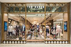 Ted Baker has announced the opening of his first store in South Africa within Sandton City, Johannesburg. The 1960 square foot retail space will house Ted's menswear, womenswear and accessory collections. Display Design, Store Design, Baker Store, Retail Interior, Sale Banner, Retail Space, Front Design, Commercial Interiors, Lamp Shades