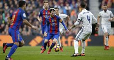 Messi surrounded by Real Madrid players in El Clasico