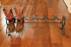Custom made 3 Pair Horseshoe Boot Rack. This will hold three pairs of boots. Each boot rack will vary in size because we make them with used horseshoes. Great gift idea too! All our products Horseshoe Projects, Horseshoe Crafts, Horseshoe Art, Horseshoe Boot Rack, Diy Shoe Rack, Shoe Racks, Custom Boots, Creation Deco, Rack Design