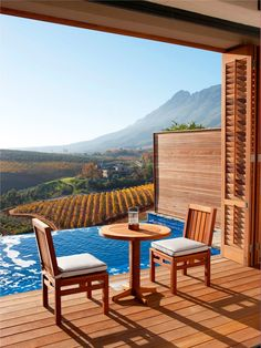 such a romantic spot! 10 Hotels with a Vineyard View (Delaire Graff Lodge in Stellenbosch, South Africa) Porches, We Are The World, Home Living, Oh The Places You'll Go, Hotels And Resorts, Luxury Hotels, Cabana, Luxury Travel, Lodges