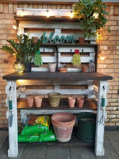 husband and I had so much fun making this potting bench. I can't wait to find some fun antique gardening pieces to add to it. Outdoor Potting Bench, Pallet Potting Bench, Pallet Garden Benches, Potting Tables, Garden Work Benches, Pallet Work Bench, Rustic Potting Benches, Garden Bench Table, Garden Bench Plans