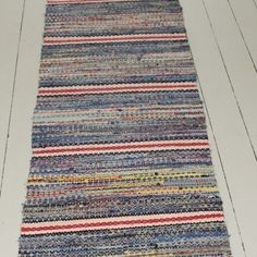 A great Rug! Very long, can be split into two rugs. Warm mix of colours. Has had a life and although in good condition, if you zoom in, the threads can be seen. I don't feel this takes away from the overall look of the rug. 100% Cotton. Dry cleaning recommended.