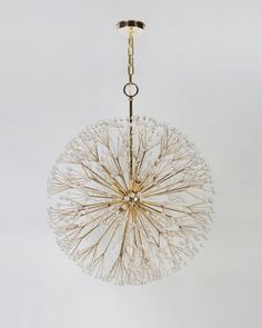 "Dandelion chandelier Inspired by Elsie de Wolfe protege Tony Duquette. Remains Lighting. Why did I only notice now that dandelion ends in ""LION."" So appropriate for that bright little yellow face that is such a fierce survivor of nature and perfect-lawn addiction."