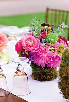 dahlias, ranunculus, tulips and moss covered centerpieces