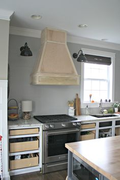 wood vent hood with stainless steel underneath More