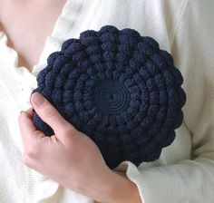 This little cutie is a crochet purse by Etsy seller jeanjeanvintage.  Adorable!