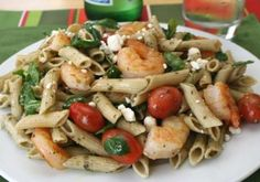 1 pound shrimp, raw (medium or large) 8 ounces pasta, penne, whole wheat 3 tablespoons pesto sauce (prepared) 2 cups tomato(es), grape or cherry 1/4 cup ...