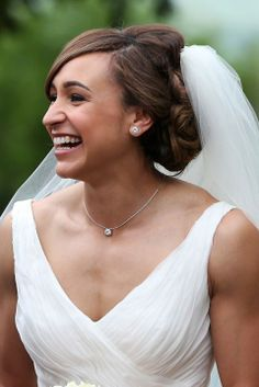 Jessica Ennis' kept it classic with her hair for her country church wedding in 2013. The gold medalist framed her face with a fringe, with the rest of her hair being teased into a perfect chignon. An updo is perfect for brides opting for a veil.