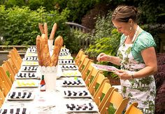 I like the idea of loaves of bread as centerpieces, stripes in the tablescape, and rectangular tables