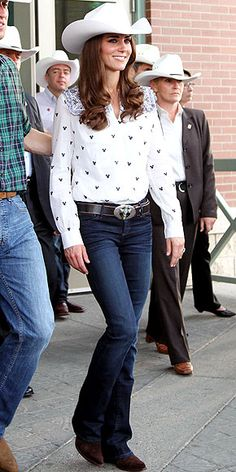 RODEO ROMANCE From tiaras to cowboy hats: The princess embraces the cowgirl spirit for a rodeo in Calgary, pairing her 10-gallon topper with a patterned Alice by Temperley London button-up, boot-leg Goldsign jeans and a big-buckle belt.