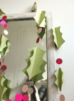 Charming + festive! This paper garland is made of 3-dimensional paper holly leaves (approx. 2-4 inches each) and pink and red paper berries (1-inch