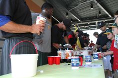 Ports players serving fans root beer floats on June 9th!