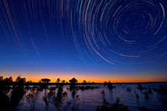 Australian photographer Lincoln Harrison captures long exposures of gorgeous star trails in the night sky above the Australian outback. He describes the grueling (and freezing) process of capturing the photos in the Daily Mail.
