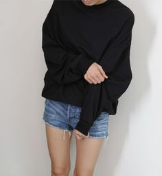 Sweater and cutoffs.