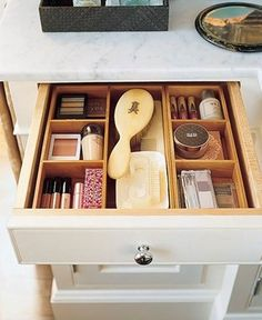 Organized makeup drawer for makeup station.