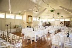 This beautiful reception hall at Summerlees, Sutton Forest, was set with elegant White Tiffany Chairs and wide banquet tables for a garden wedding. Photography: www.mintphotography.com.au #weddings #YourEventSolution