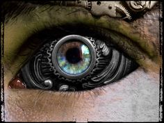 Steampunk eye....extremely interesting concept! Must do but eleborate a bit more maybe be nice on a silver metal face