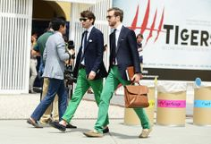 Shop this look for $219:  http://lookastic.com/men/looks/tassel-loafers-and-chinos-and-blazer-and-pocket-square-and-tie-and-dress-shirt/577  — Navy Suede Tassel Loafers  — Green Chinos  — Navy Blazer  — White Pocket Square  — Navy Tie  — White Dress Shirt