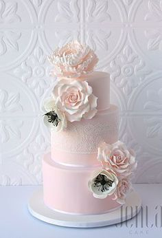 Originally designed by Leslies Matsis, this cake features edible lace and gorgeous sugar roses and anemonies with an extra large peony perched atop #weddingcakes
