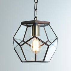 Clear Glass Prism Pentagon Pendant Light Geometric pentagon panels of clear glass create eye-catching style from the kitchen to the potting shed! Bronze frame and clear glass