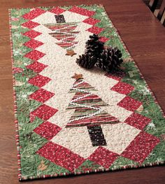 A quilter plans for the holidays year-round! Table Tinsel is a FREE quilted table runner pattern available in one easy download. Hold on to this one for the next holiday season!