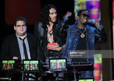 Jonah Hill, Russell Brand, and Sean 'P. Diddy' Combs speak onstage at the 2010 MTV Movie Awards held at the Gibson Amphitheatre at Universal Studios on June 6, 2010 in Universal City, California.
